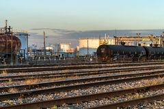 Refinery tanks and rail yard. Oil refinery tanks and rail yard  in Montreal at sunset Stock Photo