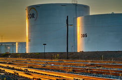 Refinery Tanks  at sunset. Oil Refinery Tanks in  Montreal east at sunset Royalty Free Stock Photos