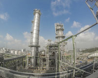 Refinery tower in wide lens Royalty Free Stock Image