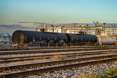 Refinery train liquid cars. Train liquid cars in a oil refinery in Montreal at sunset Royalty Free Stock Photography