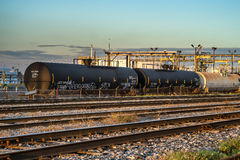 Refinery train liquid cars. Oil refinery tanks train liquid cars  in  Montreal at sunset Stock Photography