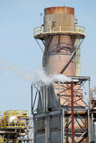 Refinery Turbine. A refinery steam turbine in operation with columns, vessels and piping against a blue sky stock photo