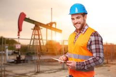 Refinery worker with digital tablet stock photos