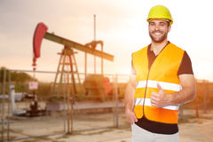 Refinery worker reads the data from the black plates Stock Photos