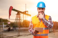 Refinery worker with digital tablet royalty free stock photo