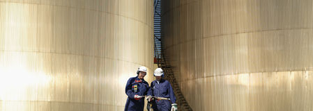 Refinery workers and fuel storage Stock Images