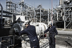 Refinery workers inside oil and gas industry stock images