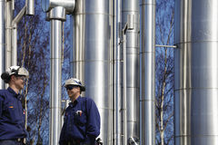 Refinery workers and pipelines Stock Photos