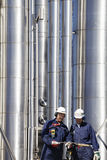 Refinery workers and pipelines Stock Images