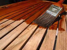Refinishing Teak. Protecting outdoor furniture royalty free stock photo