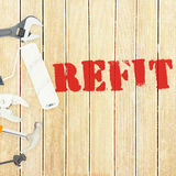 Refit against tools on wooden background Stock Photos