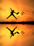Reflect of Business woman jumping and sunset silho Stock Photography