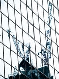Reflect of crane. Building construction abstract background Royalty Free Stock Photography