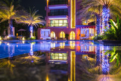 Reflect. Hua Hin in the night with building reflect on water stock photo