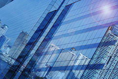 Reflect of modern city building on window glass tower, Bangkok T Stock Images