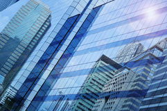 Reflect of modern city building on window glass tower. Blue tone, Bangkok Thailand stock photography