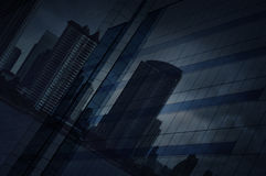 Reflect of modern city and dark strom sky on window glass tower Royalty Free Stock Photos