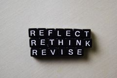 Reflect - Rethink - Revise on wooden blocks. Business and inspiration concept royalty free stock photography