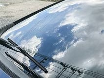 Reflect of the sky. On the windshield car stock image