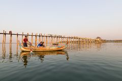 Ferryman and The tourist at U Bein Bridge 5/2/2016 stock photos