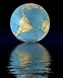 ReflectEarth. Globe of the world reflecting off a black sea Royalty Free Stock Images