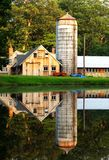 Reflected. A country barn perfectly reflected in a small pond royalty free stock image