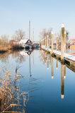 Reflected bollards in a wintry marina Stock Photo