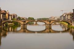 Reflected Bridge Over Arno Royalty Free Stock Image