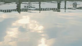 Reflected bridge and people stock video footage