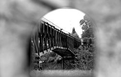 Reflected bridge. Photo on the black and white view reflected in a mirror the iron bridge for the tram located in Durcal, Granada, Andalucia, Spain Royalty Free Stock Photo
