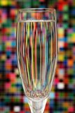 Reflected colors in a glass of water stock photo