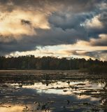 Reflected sky at Clayton lake. Reflected dramatic sky in a beatuful autumn day at Clayton lake, Ontario Stock Images