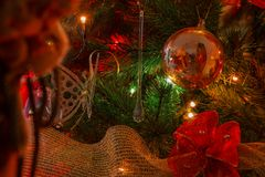 Reflected figure of Santa Claus in red glass sphere Royalty Free Stock Photo
