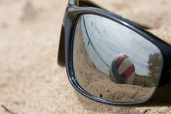 Reflected in the glasses lying on the sand Stock Images