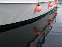 Reflected Hanging orange bouys Stock Photo