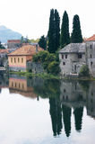 Reflected house in the river Trebisnjica Royalty Free Stock Photography