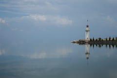 Reflected lighthouse. Marina lighthouse and clouds reflected in lake iznik, iznik, turkey royalty free stock photos