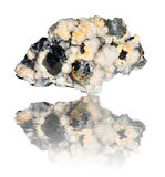 Reflected mixed mineral. Big mixed mineral rock on white stock photo