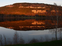Reflected Mountain. Mountain reflected in the calm water of lake Bogstadvannet in Oslo, Norway Stock Photo