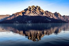 Reflected mountain. Mountain reflected in lake against blue sky royalty free stock image
