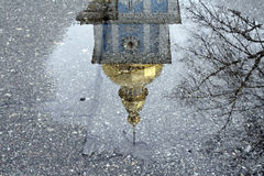 Reflected in a puddle of the bell tower of St. Michael's Golden- stock image