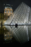Reflected in the pyramid of the Louvre Stock Photo