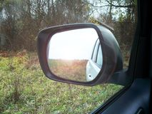 Reflected in a rearview stock images
