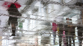 Reflected shadows on a rainy day stock image
