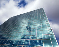 Reflected sky in a modern high rise  Stock Images