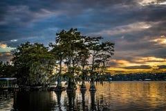 Reflected sky and trees at sunset over Lake Bruin. Beautiful reflected sky and trees at sunset over Lake Bruin in Tensas Parish Louisiana Royalty Free Stock Image