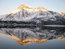 Reflected snowy mountain Stock Photo