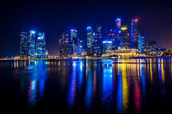 Reflected in the water the night lights of the business center in Singapore Stock Images