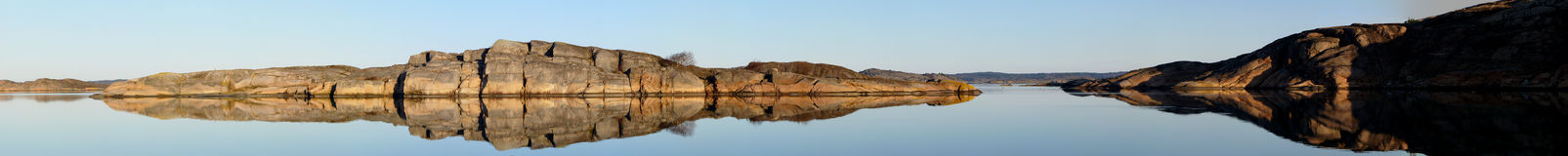 Reflected Water. Panorama of rock being reflected in still water an early morning Royalty Free Stock Image