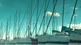 Reflected in water, yacht port on the bay, water transport. Picture of row of luxury sailboats reflected in water, yacht port on the bay, water transport, ocean stock footage
